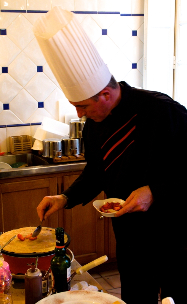 Preparing strawberry and nutella filled crepes  during the French Foodie Adventure, 2013